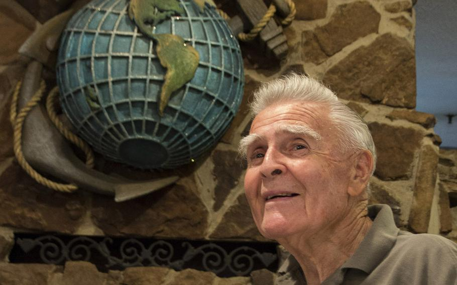 Retired U.S. Marine Corps Maj. John Fasulo poses in front of the eagle, globe and anchor at the Marine-themed Globe and Laurel Restaurant in Stafford, Va., in June, 2017.