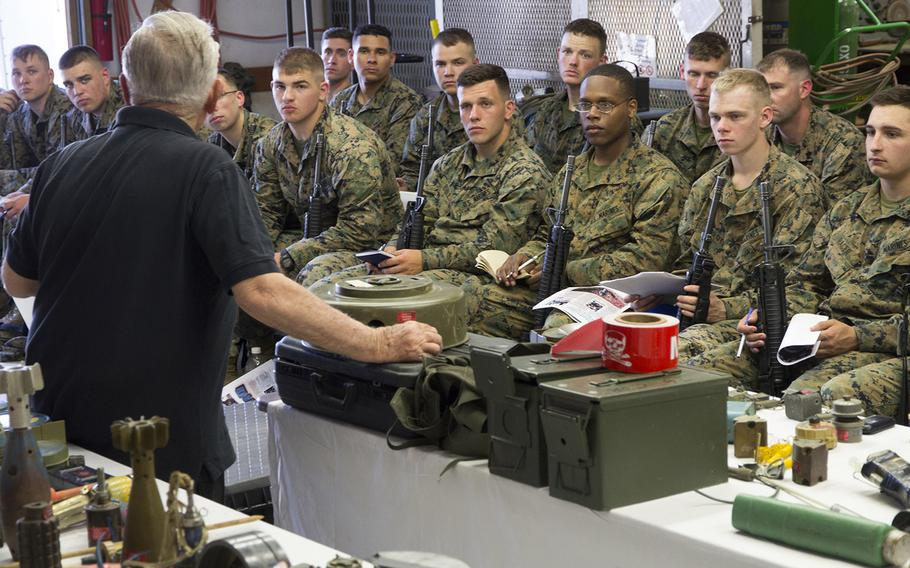 Retired U.S. Marine Corps Maj. John Fasulo talks about explosive devices during a class for Marines at Fort A.P. Hill, Va., in June, 2017.