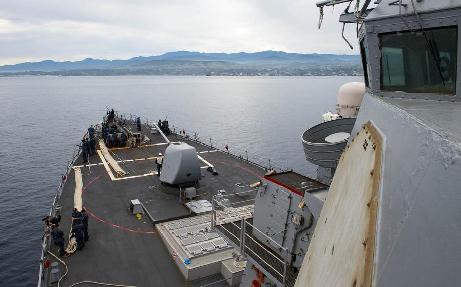 The guided-missile destroyer USS Barry approaches Guadalcanal for a port visit to commemorate the 75th anniversary of World War II's Battle of Guadalcanal, Friday, Aug. 4, 2017.