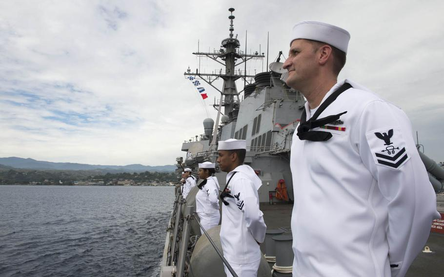 Sailors stand at parade rest as the guided-missile destroyer USS Barry pulls into Guadalcanal for a port visit to commemorate the 75th anniversary of the famous World War II battle, Friday, Aug. 4, 2017.