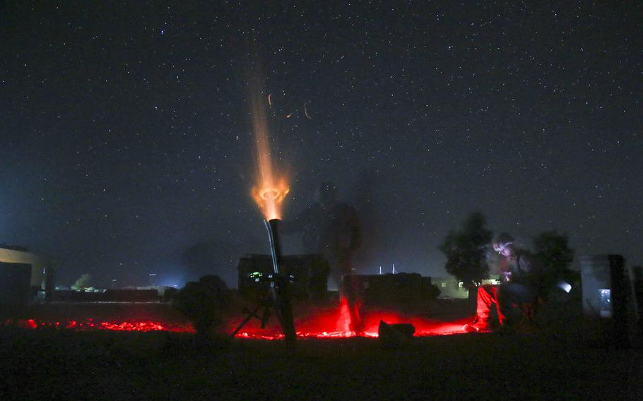 U.S. Marines with Task Force Southwest fire a non-explosive illumination round from an 81mm mortar at Camp Shorserack, Afghanistan, July 15, 2017. Defense Secretary Jim Mattis said Thursday, Aug. 17, 2017, that he expects President Donald Trump to soon reach a decision on the new strategy for the region and the military's role in Afghanistan.