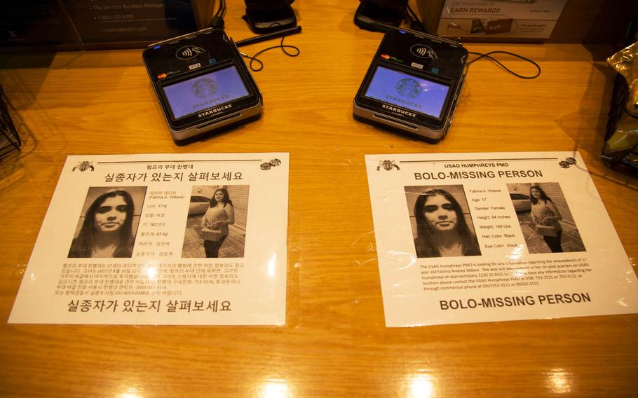 A missing person notice for 17-year-old Fatima Andrea Wdave is seen at a Starbucks at Camp Humphreys, South Korea, Monday, Aug. 21, 2017.