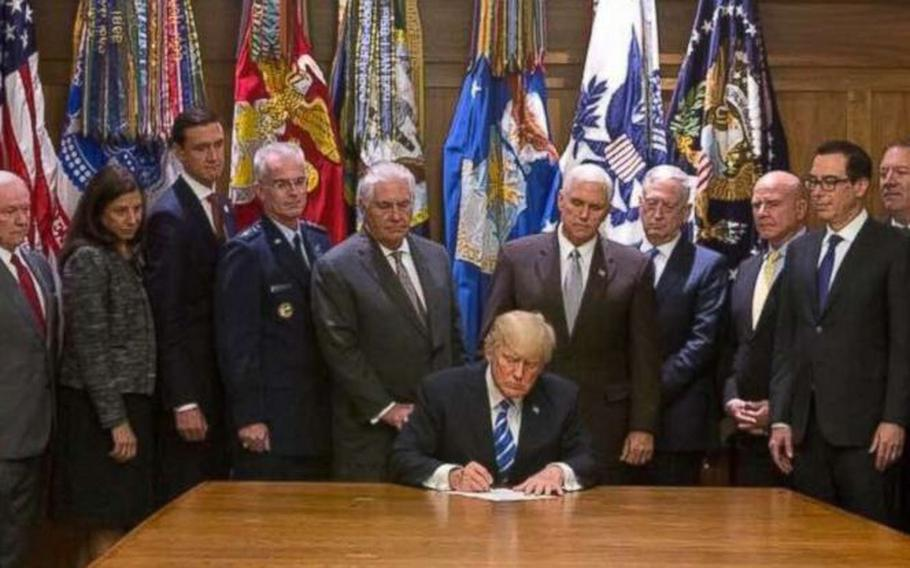 President Donald Trump signs the Global War on Terrorism War Memorial Act on Aug. 18, 2017, at Camp David in Maryland.