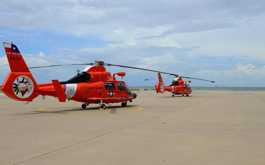 Two MH-65 short-range aircraft sit prepped and ready ahead of Hurricane Harvey as the Coast Guard prepares for response efforts at Air Station Corpus Christi in Corpus Christi, Texas, on Aug. 24, 2017.