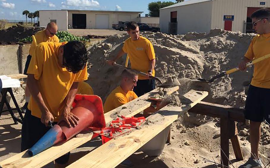 Naval Air Station Corpus Christi personnel fill sandbags on Thursday, Aug. 24, 2017, in preparation for Hurricane Harvey.