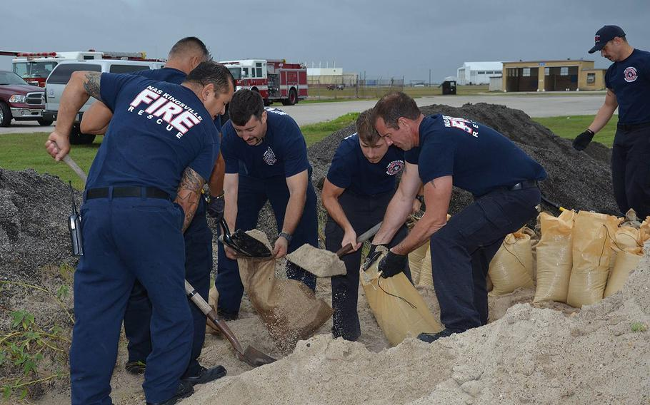 Naval Air Station Kingsville personnel fill sandbags on Friday, Aug. 25, 2017 in preparation for Hurricane Harvey.