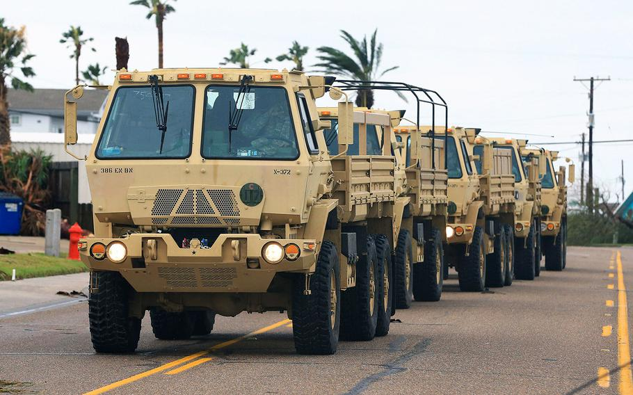 National Guard vehicles arrive at Port Aransas, Texas, after Hurricane Harvey landed in the Coast Bend area on Saturday, Aug. 26, 2017.
