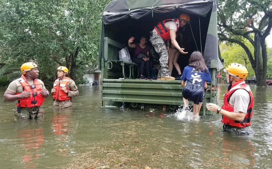 Texas National Guard soldiers arrive in Houston, Texas to aid citizens in heavily flooded areas from the storms of Hurricane Harvey Aug 27, 2017.