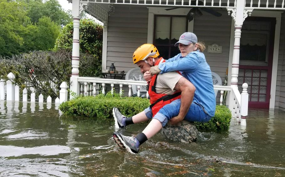 Texas National Guard soldiers conduct rescue operations in flooded areas around Houston on Aug. 27, 2017.