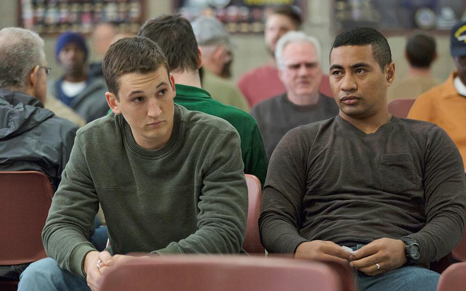 """Miles Teller, left,  and Beulah Koale star in DreamWorks Pictures' """"Thank You for Your Service.""""  The drama follows a group of U.S. soldiers returning from Iraq who struggle to integrate back into family and civilian life, while living with the memory of a war that threatens to destroy them long after they've left the battlefield."""