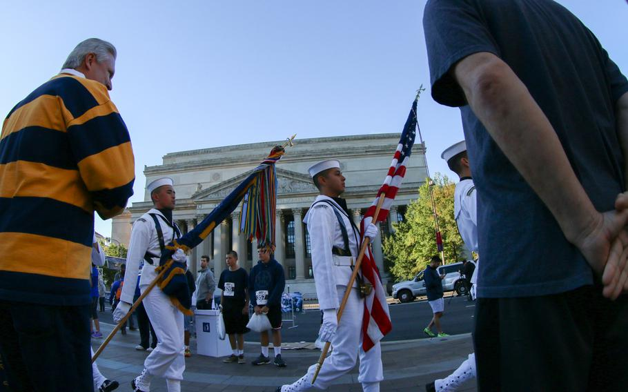 The annual Navy Mile fun run took place in Washington on Oct. 1, 2017, with runners of all ages turning out to participate. A Naval color guard marches out the flags following the National Anthem.