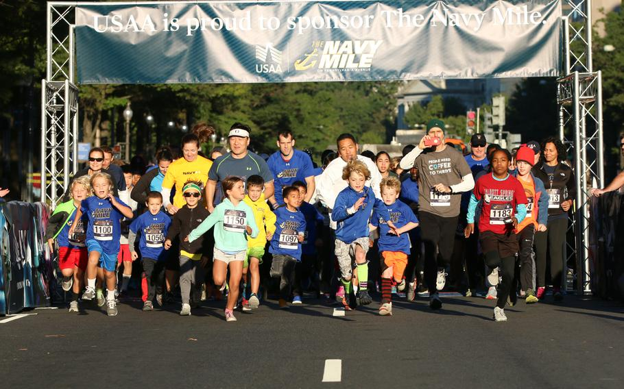 The annual Navy Mile fun run took place in Washington on Oct. 1, 2017, with runners of all ages turning out to participate. Here, the mixed age group kicks off the days' events with the earliest heat.