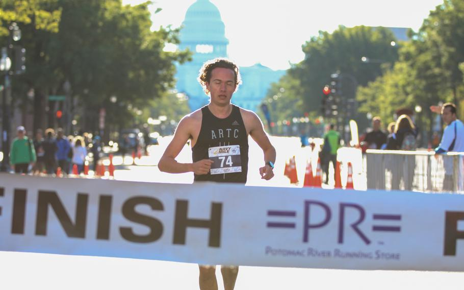Daniel Ritter crosses first during the second heat of the 2017 Navy Mile fun run held in Washington on Oct. 1, 2017.