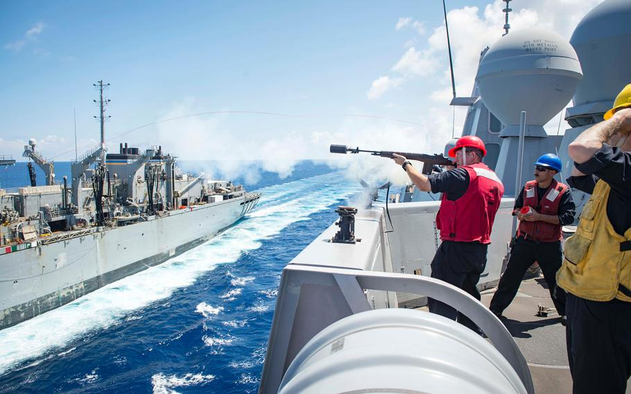 Petty Officer 2nd Class Vincent Lendway shoots a line from the amphibious transport dock ship USS New York (LHD 21) to fast combat support ship USNS Supply (T-AOE 6) during a replenishment at sea as part of relief efforts following Hurricane Irma's landfall in Key West, Fla., on Sept. 16, 2017. The New York,  along with the USS  Iwo Jima, was ordered to get underway Saturday, Oct. 7, from Naval Station Mayport, Fla., to ready a disaster relief response to Tropical Storm Nate.