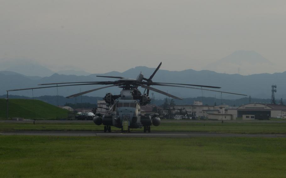A CH-53E Super Stallion rests on a ramp at Yokota Air Base, Japan on Sept. 13, 2017.