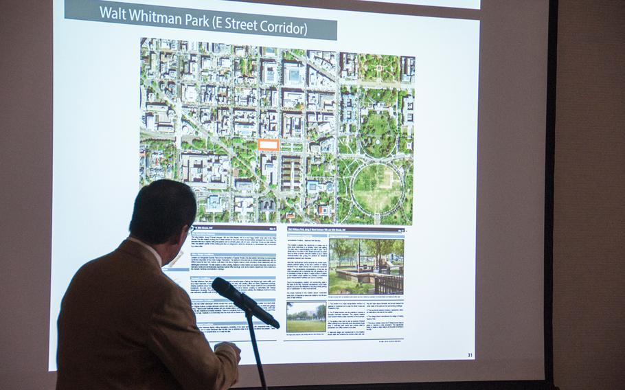 Alan Harwood, an excutive with the AECOM design firm working with the National Desert Storm and Desert Shield Memorial group, makes a presentation for the possible sites for a memorial during a hearing before the U.S. Commission of Fine Arts in Washington, D.C., on Thursday, Oct. 19, 2017. The slide displayed on the screen shows the memorial group's second choice at Whitman Park on E Street, just two blocks west of the White House complex.