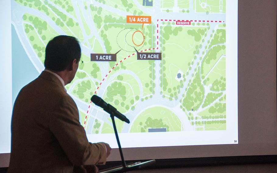 Alan Harwood, an excutive with the AECOM design firm working with the National Desert Storm and Desert Shield Memorial group, makes a presentation for the possible sites for a memorial during a hearing before the U.S. Commission of Fine Arts in Washington, D.C., on Thursday, Oct. 19, 2017. The slide displayed on the screen shows the memorial group's preferred site on the corner of Constitution Ave and 23rd Street.