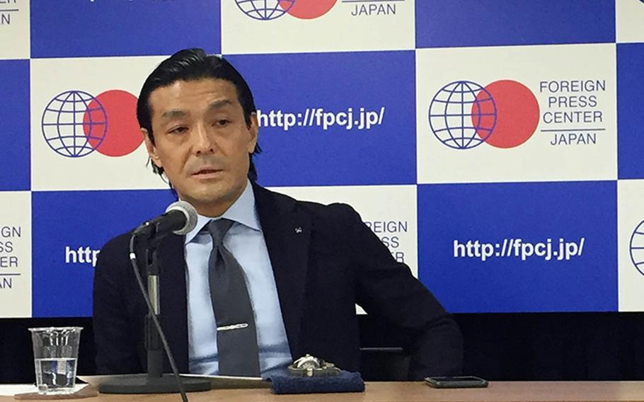 Toshihiro Nakayama, a professor at Tokyo's Keio University, speaks about President Donald Trump's upcoming visit to Japan at the Foreign Press Center in Tokyo, Oct. 30, 2017.