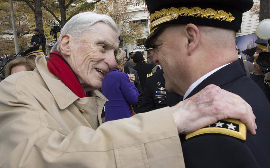 Former Sen. John Warner, R-Va., talks with Army Chief of Staff Gen. Mark Milley after the groundbreaking ceremony for the National World War I Memorial at Pershing Park in Washington, D.C., Nov. 9, 2017.
