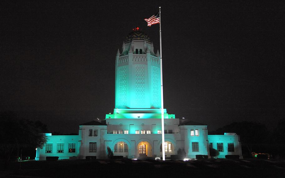 In an April, 2015 file photo, the Taj at Joint Base San Antonio-Randolph in Texas is bathed in teal lighting in recognition of Sexual Assault Awareness and Prevention Month.