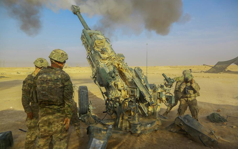 U.S. Army soldiers assigned to 5-25 Field Artillery, Battery C, 2nd Platoon fires a Howitzer M-777 A2 in support of Iraqi Security Forces near Al Qaim, Iraq, Nov. 07,  2017.