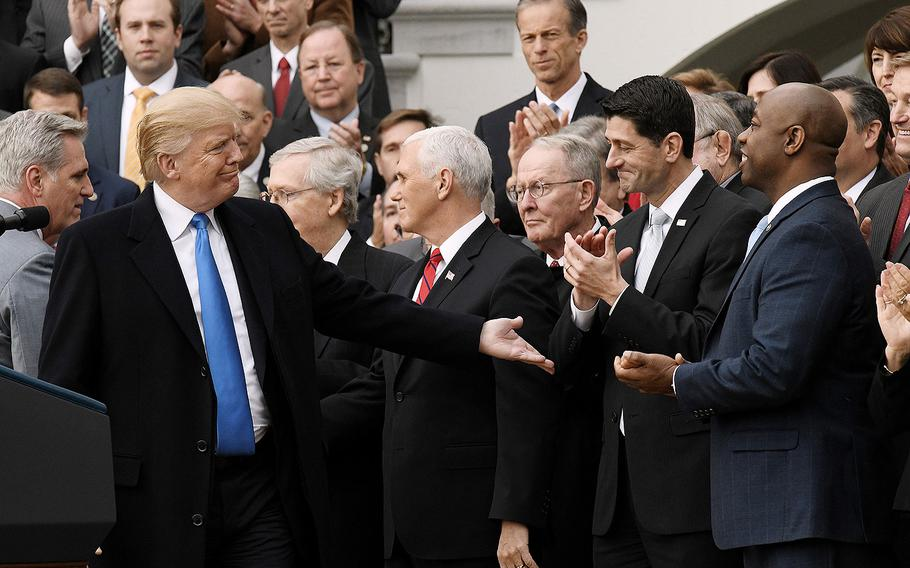 President Donald Trump acknowledges House Speaker Paul Ryan during a celebration of the tax bill's passage with members of the House and Senate on Wednesday, Dec. 20, 2017 during an event on the South Portico of the White House in Washington, D.C.