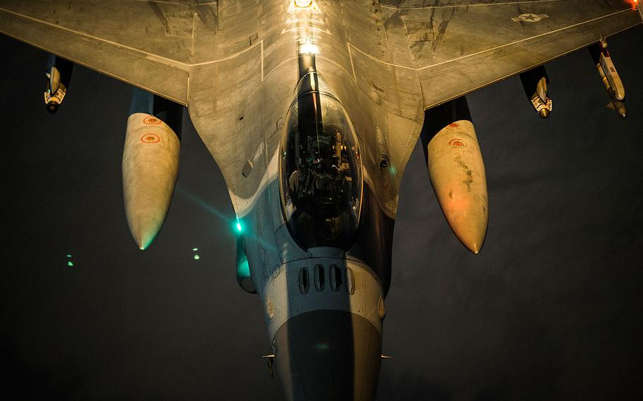 A U.S. Air Force F-16C Fighting Falcon performs refueling operations with a KC-10 Extender while conducting air patrols and possible air strikes in Iraqi and Syrian airspace in support of Operation Inherent Resolve, Dec. 02, 2017.
