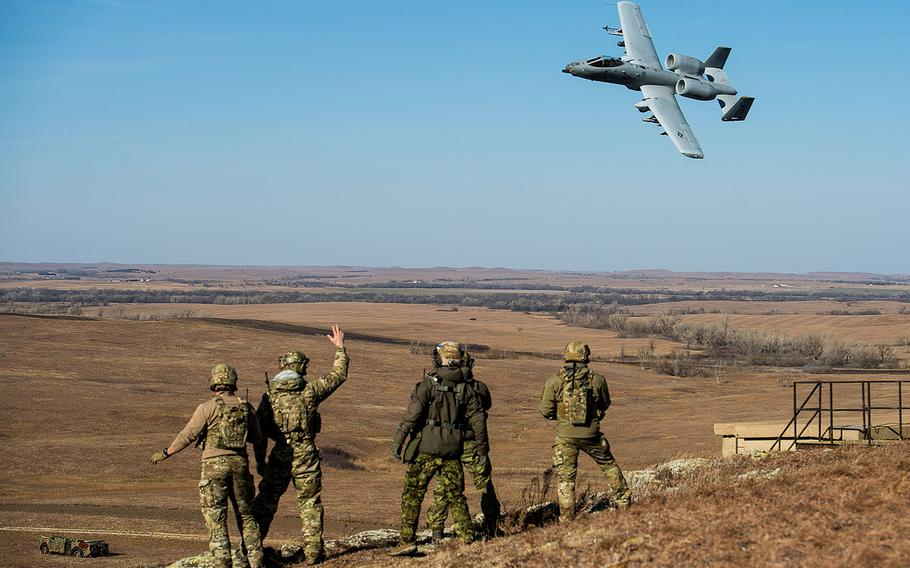 Members of the 146th Air Support Operations Squadron, from Oklahoma City, and Estonian tactical air control party specialists acknowledge a 442nd Fighter Wing A-10 Thunderbolt II from Whiteman Air Force Base, Missouri on Dec. 13, 2017.