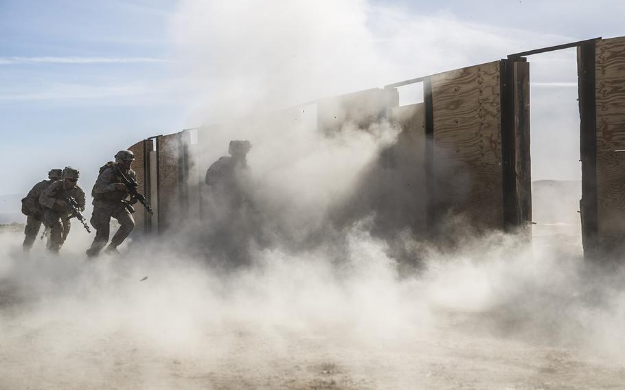 Marines with 3rd Battalion, 7th Marine Regiment, participate in door breaching training a Marine Corps Air Ground Combat Center Twentynine Palms, Calif., Feb. 9, 2018. The Pentagon on Wednesday, Feb. 15, 2018, introduced a new policy that will require servicemembers to be deployable within 12 months or be forced out of the armed services.