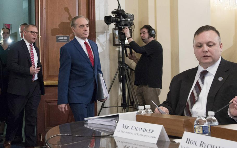 VA Secretary David Shulkin arrives for a House Veterans' Affairs Committee hearing on Capitol Hill, Feb. 15, 2018. Already seated is VA Deputy Assistant Secretary for Resource Management Richard Chandler.