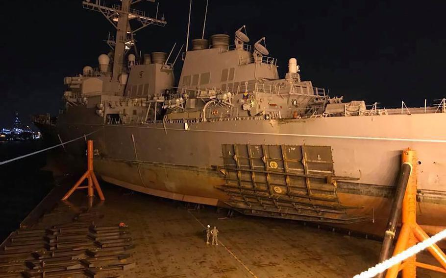 The Arleigh Burke-class guided missile destroyer USS John S. McCain (DDG 56) is being loaded on heavy lift transport MV Treasure, Oct. 06, 2017.