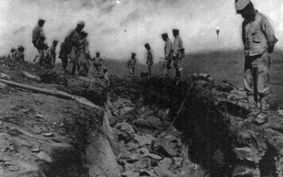 Removing the dead from trenches in World War I. Courtesy of Library of Congress.