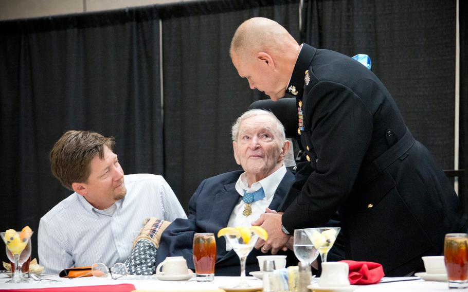 Commandant of the Marine Corps Gen. Robert B. Neller, right, shakes hands with World War II veteran and Medal of Honor recipient Charles H. Coolidge during the 67th Armed Forces luncheon at Chattanooga, Tenn., May 6, 2016. Coolidge died April 6, 2021, at 99.
