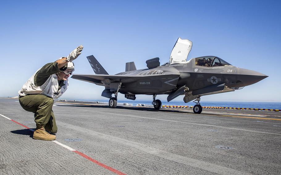 U.S. Marine Sgt. Maj. Allen Goodyear, the squadron sergeant major for Marine Fighter Attack Squadron (VMFA) 211, Marine Aircraft Group 13, 3rd Marine Aircraft Wing, signals for an F-35B Lightning II to launch from the flight deck of the USS Essexduring Exercise Dawn Blitz, Oct. 24, 2017.