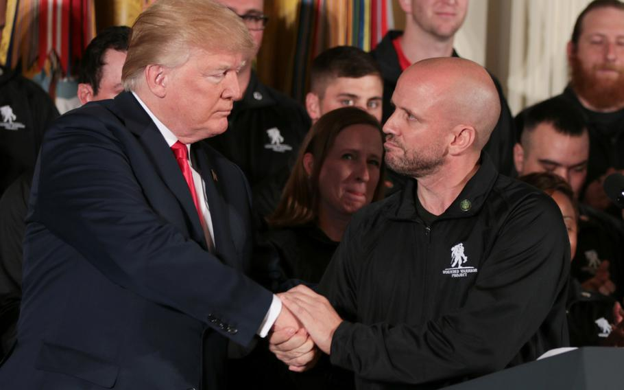 President Donald Trump shakes hands with Dan Nevins, a combat-injured soldier, after Nevins gave a speech at the White House on Thursday, April 26, 2018.