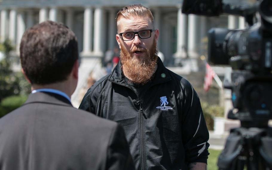 Deven Schei, a former Army combat engineer and current participant in the Wounded Warrior Project Soldier Ride, speaks to a reporter on the White House lawn on Thursday, April 26, 2018.