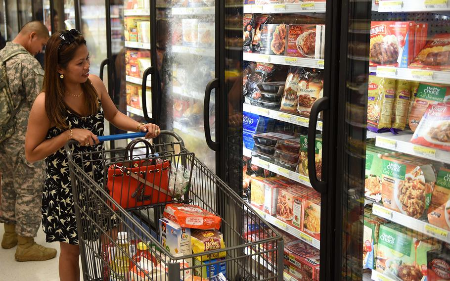 A patron shops in the frozen foods aisle at the Camp Carroll Commissary in South Korea in 2015.