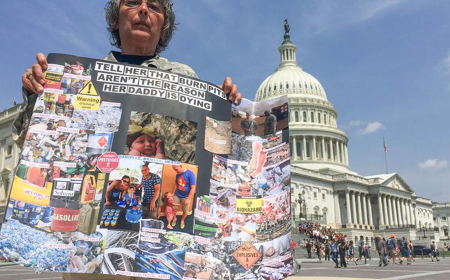 Susan Zeier holds a sign showing the different elements that were burned in pits. Her son-in law was diagnosed with cancer and it's believed to have been contracted due to exposure to burn pits when he was a soldier in Iraq. Zier was at a news conference in front of U.S. Capitol in Washington on June 7, 2018.