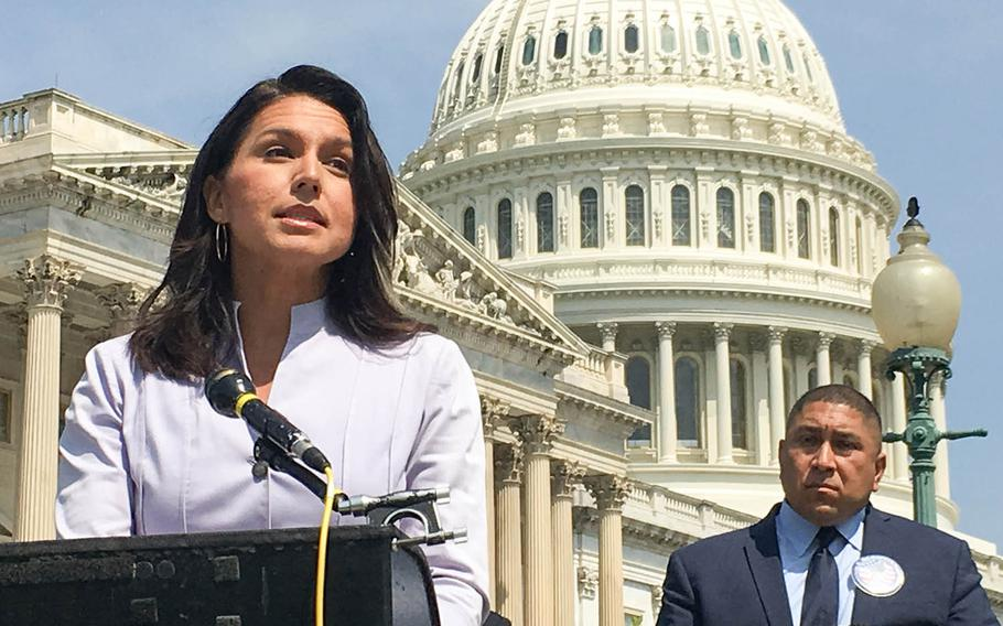 Rep. Tulsi Gabbard, D-Hawaii, speaks in front of the U.S. Capitol at a news conference about the need for Congress to support legislation creating better medical benefits for veterans suffering from illnesses contracted due to exposure to burn pits.