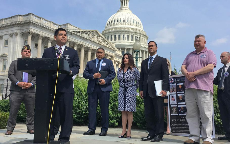 Rep. Raul Ruiz, D-Calif., speaks in front of the U.S. Capitol at a news conference about the need for Congress to support legislation creating better medical benefits for veterans suffering from illnesses contracted due to exposure to burn pits.
