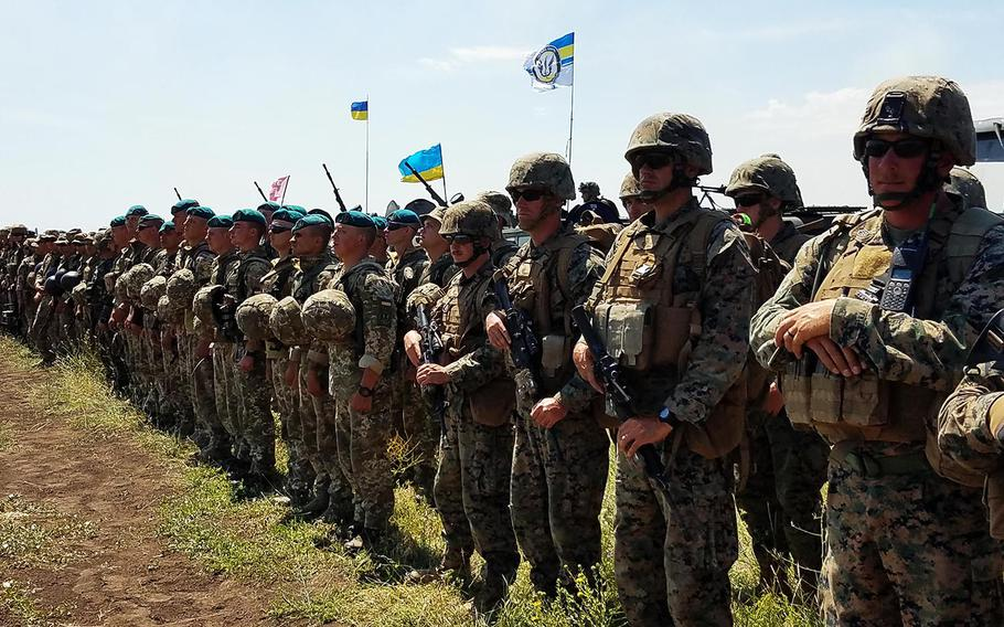 U.S. and Ukrainian Marines stand together after a company-level attack during the land portion of Exercise Sea Breeze, Saturday, July 14, 2018.