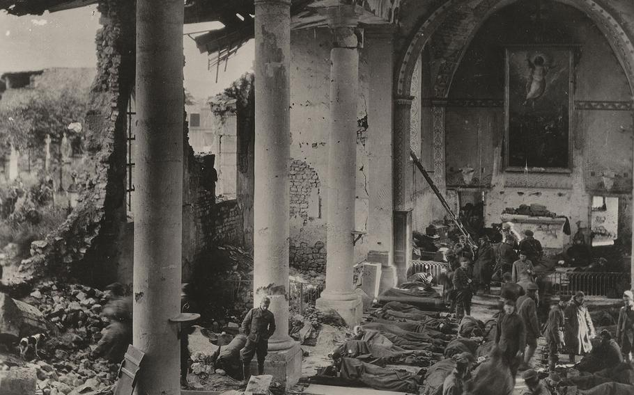 Wounded soldiers are treated by the 110th Sanitary Train, 137th Field Hospital, 35th Division, in an old church in Neuville, Meuse, France on Sept. 20, 1918.