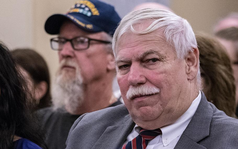 """Retired Cmdr. John Wells, executive director of the Military Veterans Advocacy, Inc., listens to testimony on Wednesday, Aug. 1, 2018, during a Senate Veterans Affairs Committee hearing on Capitol Hill in Washington. """"We're disappointed in the testimony of the undersecretary,"""" Wells said after the hearing."""