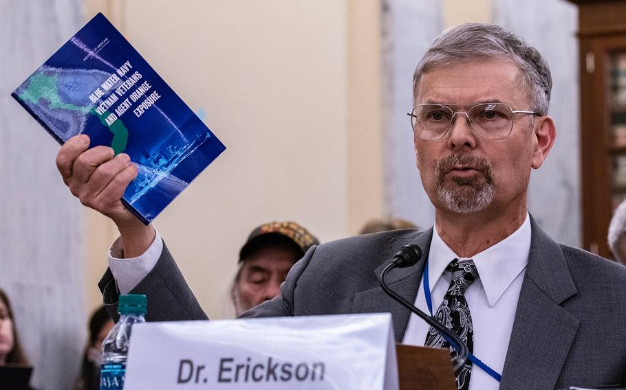 Dr. Ralph Erickson, a VA expert on post-deployment health issues, holds up a pamphlet addressing the Blue Water Navy veterans, while giving testimony on Wednesday, Aug. 1, 2018, at a Senate Veterans Affairs Committee hearing, as members heard arguments for and against the Blue Water Navy Vietnam Veterans Act. Erickson told senators most of the ailments presumed to be caused by Agent Orange also are tied to aging.