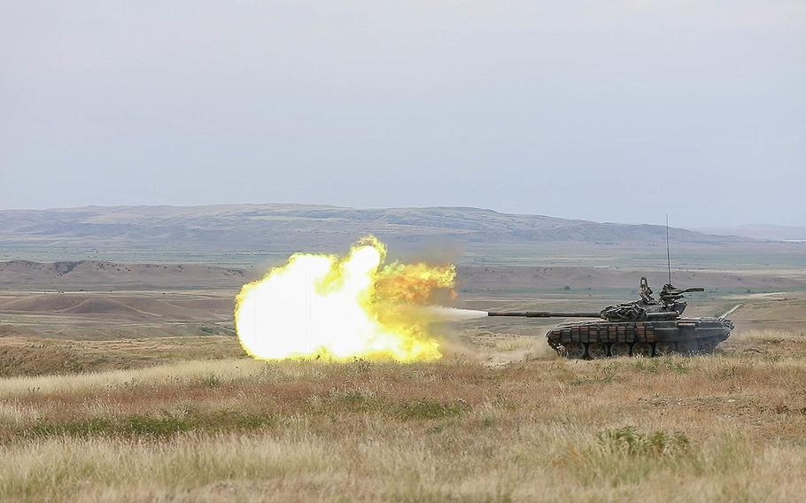 A Georgian Armed Forces T-72 tank engages targets down range as part of a live fire training during Noble Partner 18 at the Vaziani Training Area, Georgia, Aug. 4, 2018.