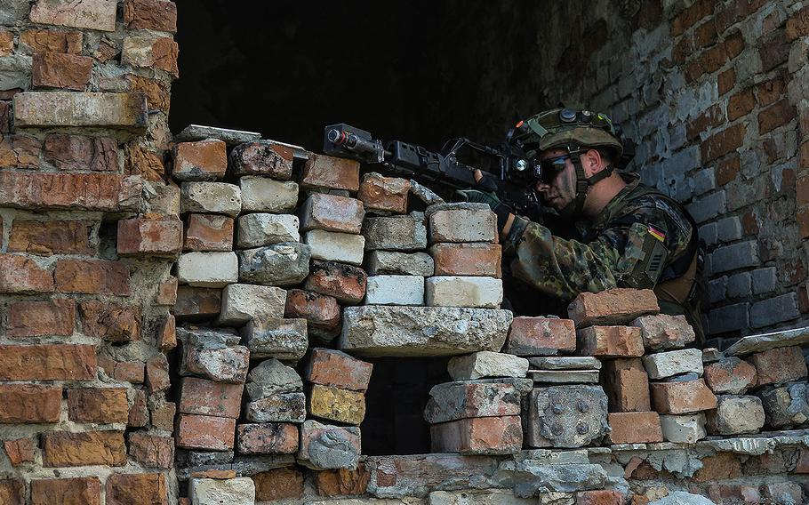 A German army infantryman with the 391st Mechanized Infantry Battalion pulls security in a recently-secured building at Vaziani Training Area, Georgia, Aug. 5, 2018.