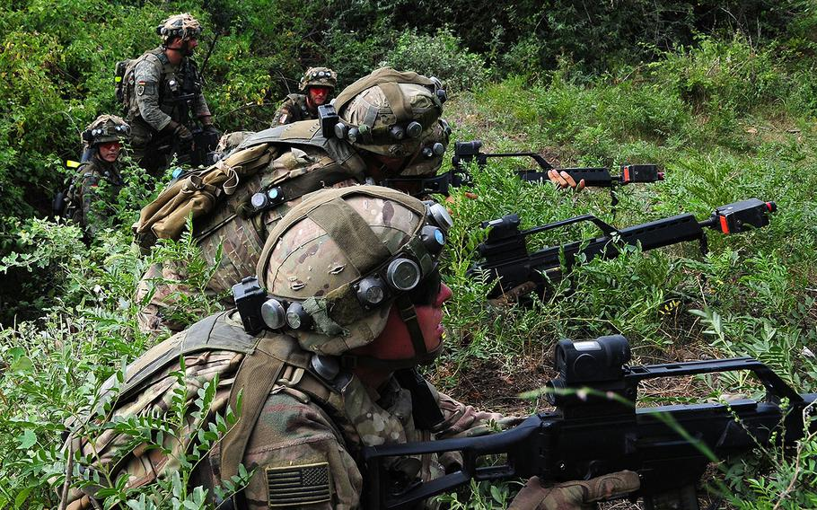 German and U.S. soldiers prepare an assault during a Military Operations On Urban Terrain training exercise as part of Noble Partner 2018 at Vaziani Training Area, Georgia, Aug. 4, 2018.