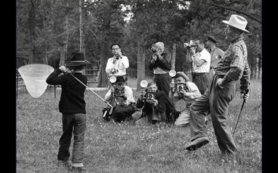 Former President Dwight D. Eisenhower gives his grandson a golf lesson at Fraser, Colo., in August 1955. Eisenhower was an enthusiastic golfer and his vacation home was an easy stroll from the greens at the Augusta National Golf Club in Georgia.