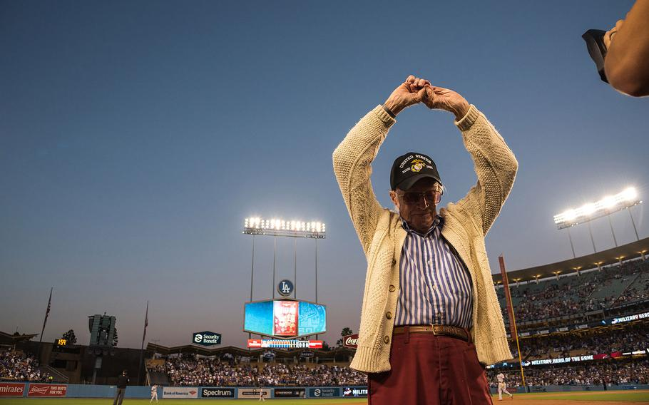 Marine veteran Sam Folsom, 98, who flew fighters at Guadalcanal in World War II, where he shot down three Japanese aircraft, and served later in the Korean War is honored on the field at Dodger Stadium on Aug. 14, 2018.