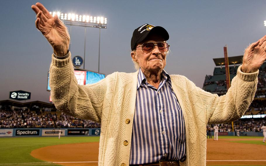 Marine veteran Sam Folsom, 98, who flew fighters at Guadalcanal in World War II, where he shot down three Japanese aircraft, and served later in the Korean War is honored on the field at Dodger Stadium Aug. 14, 2018.